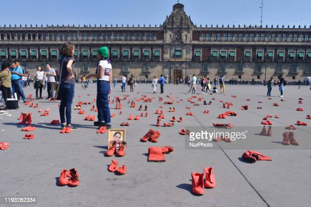 Group of women join at Zocalo to take part during a protest with red-painted shoes to celebrate 30 years of feminicide in Mexico and demand justice...