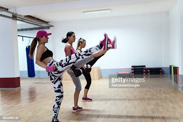 Group of Women Kick Boxing in Health Club