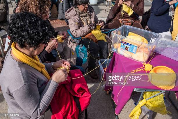 A group of women knitting yellow wool scarves Several tents occupy the Plaza Catalunya in Barcelona to claim Carles Puigdemont as President of...