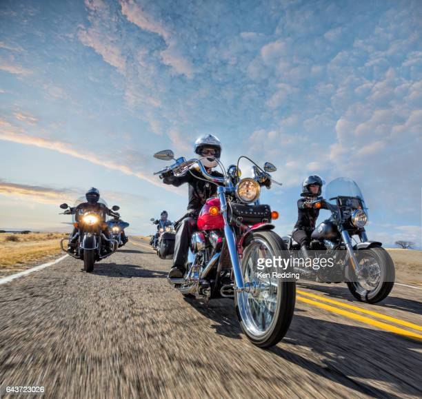 group of women motorcyclists - motorcycle stock pictures, royalty-free photos & images