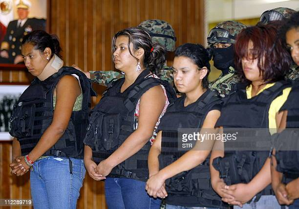 Group of women of Los Zetas drug cartel are presented to the press at the Mexican Navy headquarters in Mexico City on April 17, 2011. The women were...