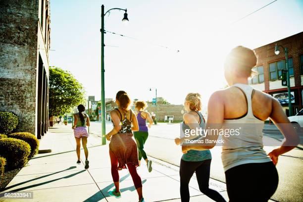 Group of women on morning run on sidewalk
