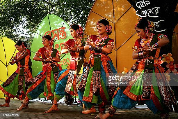 A group of women performing a dance on the Basanta Utsav or Basanta festival celebrating the Bengali month of Falgoon at the Institute of Art of...