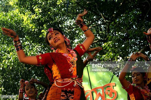 A group of women performing a dance on the Basanta Utsav or Basanta festival celebrating the Bengali month of Falgoon at the Art Institute of Dhaka...