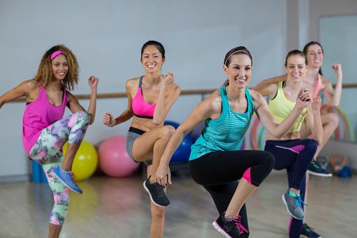Group of women performing aerobics 650196074