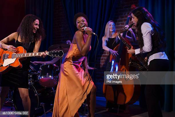 group of women performing jazz band on stage - performance group stock pictures, royalty-free photos & images