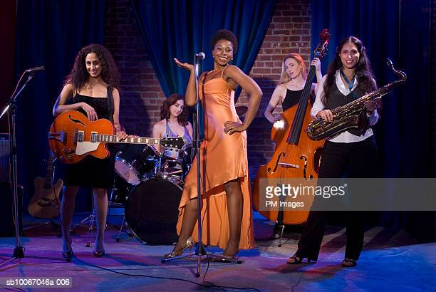 Group of women performing jazz band on stage, Portrait