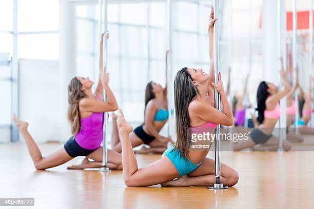 Group of women pole dancing