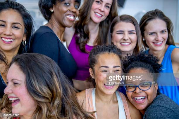 group of women posing for picture - only women stock pictures, royalty-free photos & images