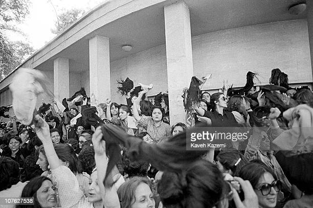 A group of women protest against wearing Islamic Veil while spinning their veils in the air outside prime minister's offices 6th July 1980 Tehran Iran