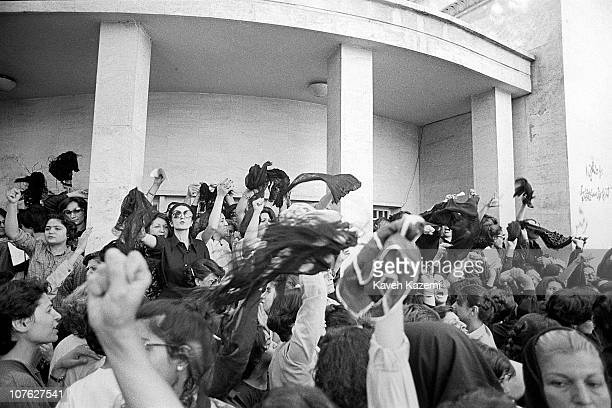 A group of women protest against wearing the Islamic veil while waving their veils in the air outside the office of the Prime Minister Tehran Iran...