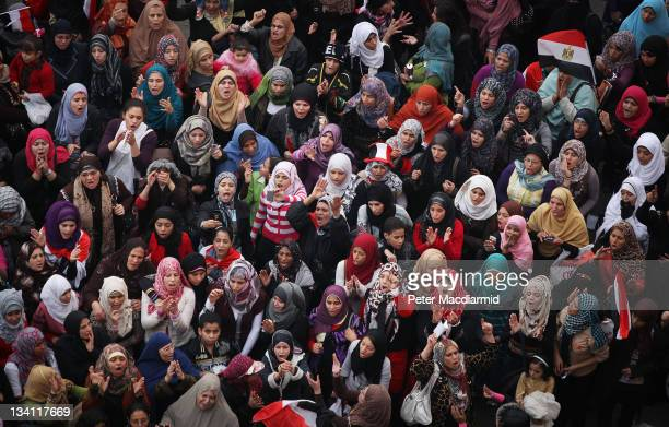 A group of women protestors chant and sing in Tahrir Square on November 26 2011 in Cairo Egypt Thousands of Egyptians are continuing to occupy Tahrir...