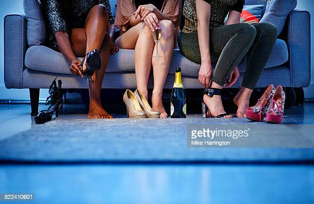 group of women putting on heels before night out - beautiful female feet stock photos and pictures