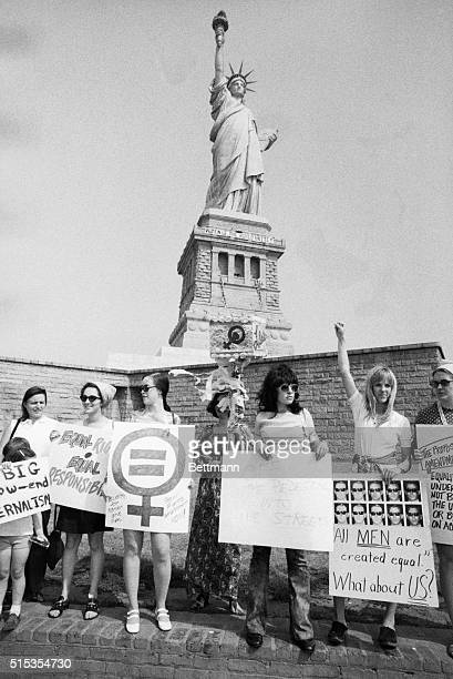 A group of women rally at the Statue of Liberty in support of the recent passage of the Equal Rights Amendment by the United States House of...