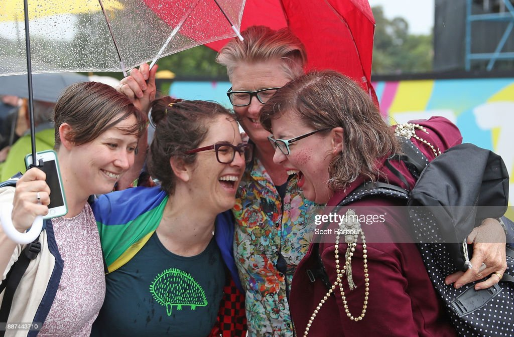 A group of women react as they gather with a crowd of people to watch a large television screen at Federation Square as it is announced that same-sex marriage will be legal in Australia with Parliament agreeing to change the Marriage Act and end the ban on gay and lesbian couples marrying on December 7, 2017 in Melbourne, Australia. The historic bill was passed on the final day of parliamentart sitting for 2017. The legislation means same-sex couples will now be able to be legally married in Australia. Australians voted 'Yes' in the Marriage Law Postal Survey for the law to be changed in November.