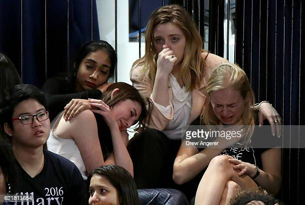 Group of women react as voting results come in at Democratic presidential nominee former Secretary of State Hillary Clinton's election night event at...