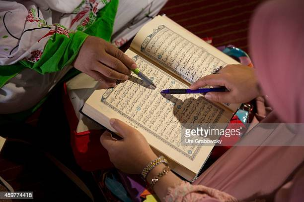 Group of women reading and interpreting the Quran at the Istiqlal Mosque also called Masjid Istiqlal on November 03 in Jakarta Indonesia The Istiqlal...