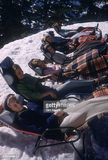 A group of women reclining on sun loungers at Gstaad 1961