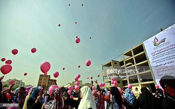 A group of women release pink balloons into the sky during an event organized in order to inform citizens about breast cancer in El Katibe Square in...