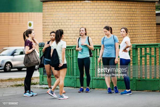 group of women resting after run together - blue shoe stock pictures, royalty-free photos & images