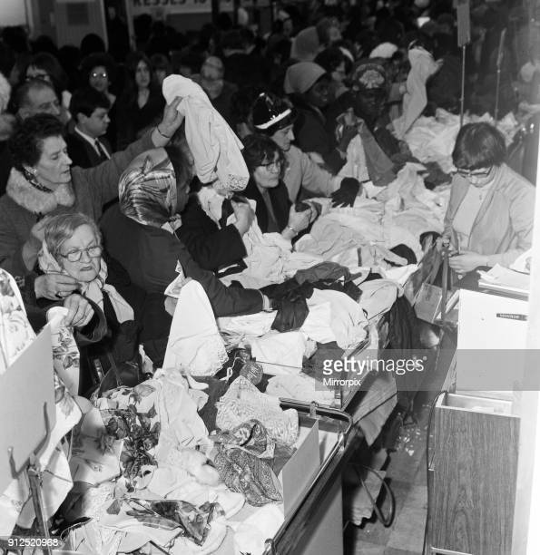 A group of women round one the counters at CA on Oxford Street trying to snap up a bargain in the sale which started today 3rd January 1966