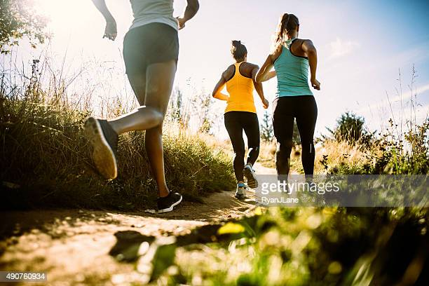 Group of Women Running Dirt Trail