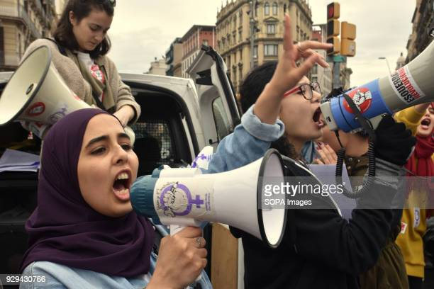 A group of women seen chanting slogan with loud speakers during the March 8 international women's day protest to demand equal better salary and more...