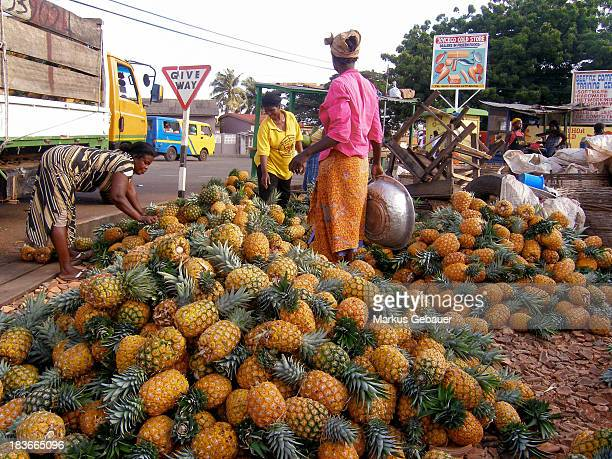 Group of women select pineapples to sell them on the market - Accra, Ghana, West Africa.