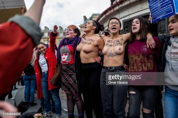 A group of women shout slogans during the International Women's Rights Day protest on March 08 2019 in Paris France Several thousand people...