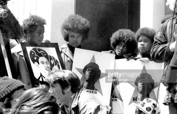 A group of women show their support for the Black Panther Party while holding signs with the picture of Minister of Defense Huey P Newton on May 1...