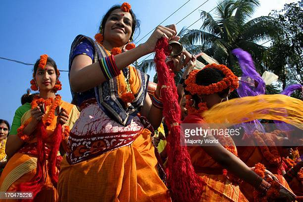 A group of women singing on the Basanta Utsav or Basanta festival celebrating the Bengali month of Falgoon at the Art Institute of Dhaka University...