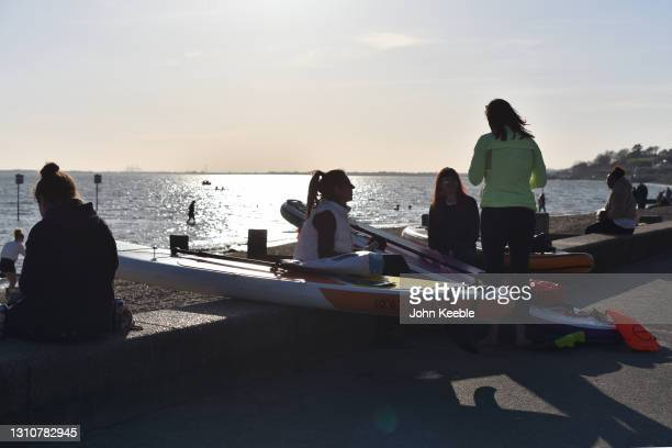 Group of women sit and chat with their paddle boards on a warm sunny Easter Sunday at Chalkwell beach on April 04, 2021 in Southend-on-Sea, England....