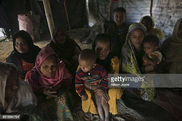 A group of women sit on the floor of their home in Balu Kali refugee camp is seen on January 17 2017 in Cox's Bazar Bangladesh They are all relatives...