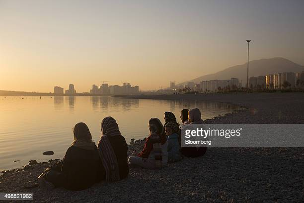 A group of women sit on the shore of an artificial lake in Chitgar Park northwest of Tehran Iran on Wednesday 25 Nov 2015 Iran will encourage foreign...