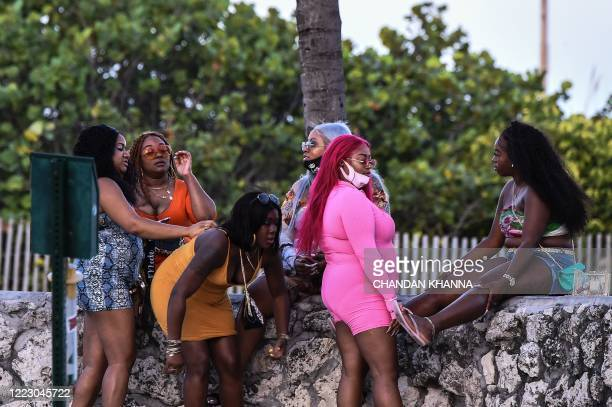 Group of women sits at the Miami Beach, Florida on June 26, 2020. - They are itching for a good time after months of lockdown, and may the...