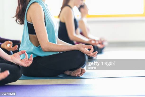 Group of women sitting on meditation session in yoga class