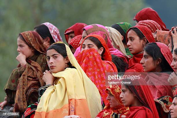CONTENT] A group of women sitting on the roofs watching the polo match which was played among two valley's team of Azad Kashmir at Kail Sharda...