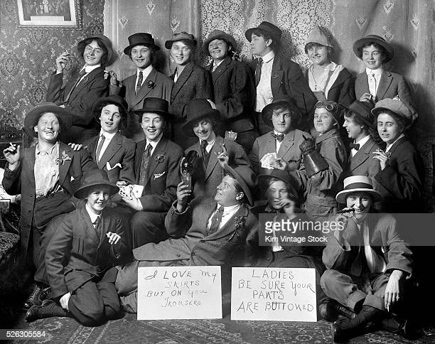 A group of women smoke drink and play cards while having their photo taken dress as men in Chicago