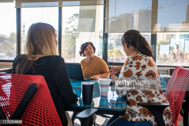 group of women, some with cerebral palsy sitting down having a meeting - stock video - david freund stock pictures, royalty-free photos & images