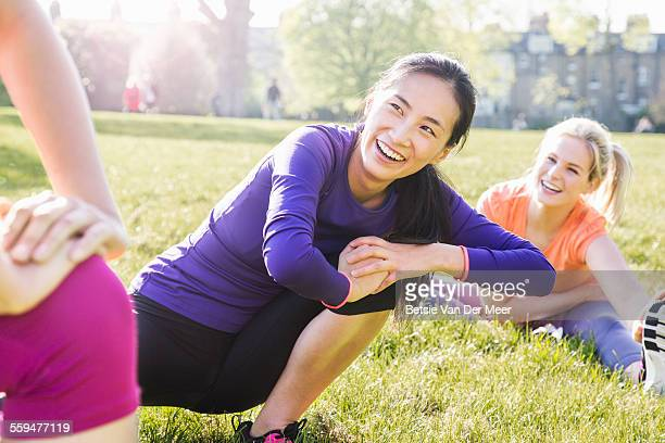 Group of women stretching in park