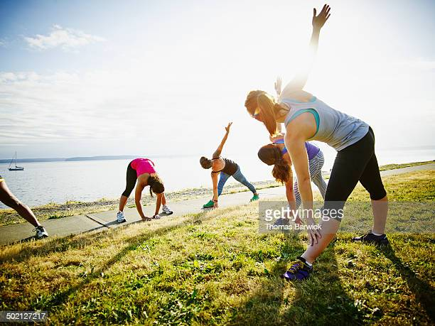 Group of women stretching together before run