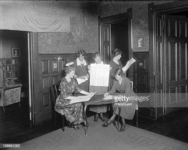 A group of women suffragettes gather in preparation for voting 1921