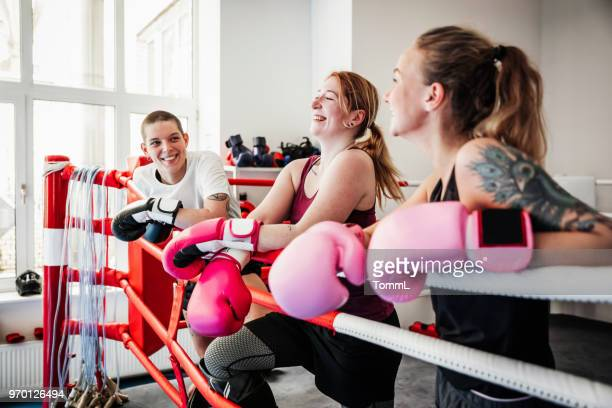 group of women taking break from kickboxing training together - amateur stock pictures, royalty-free photos & images