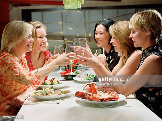 Group of women toasting at dinner