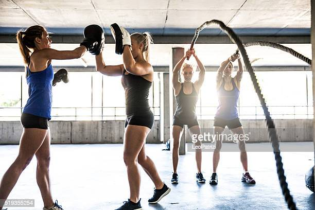 Group of women training on rope and boxing