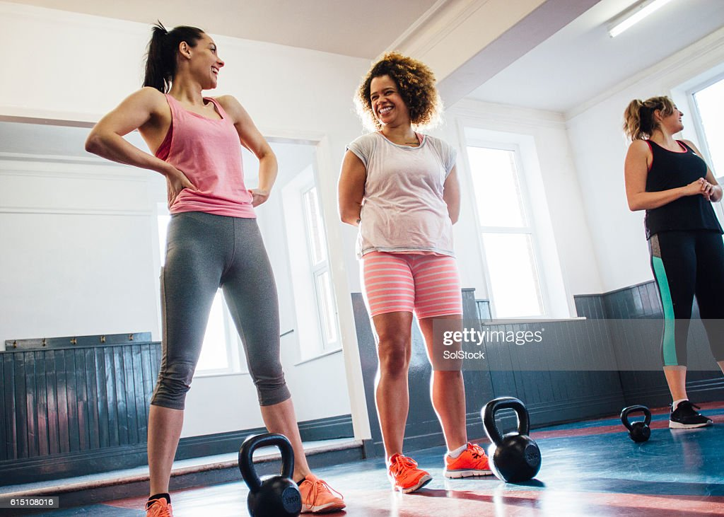 Group of Women Training with Kettle Bells : Stock Photo