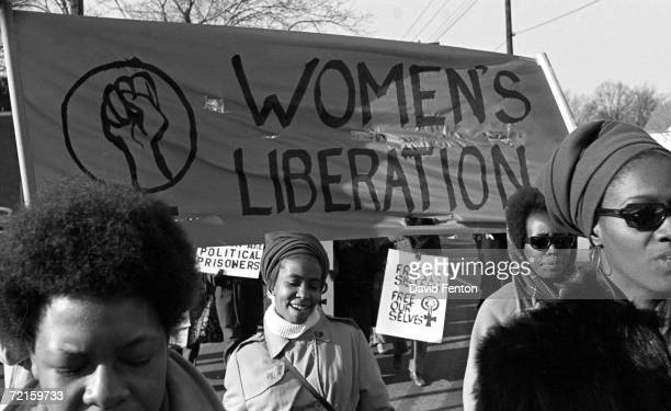 A group of women under a 'Women's Liberation' banner march in support of the Black Panther Party New Haven Connecticut November 1969