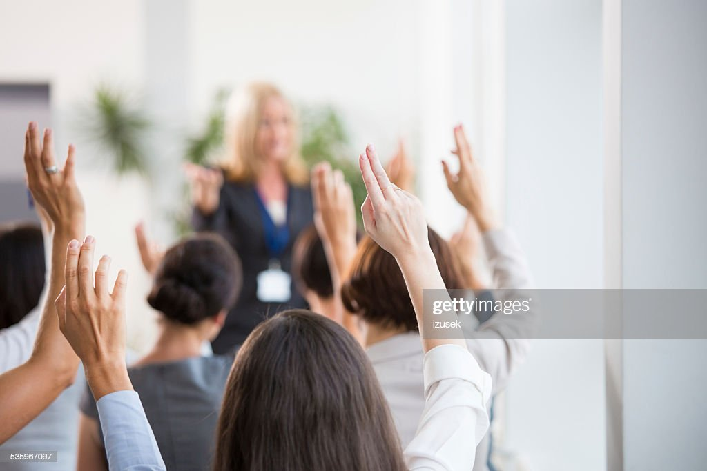 Group of women voting during seminar : Stock Photo