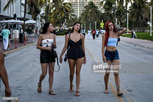 A group of women walk on Ocean Drive in Miami Beach Florida on June 26 2020 They are itching for a good time after months of lockdown and may the...