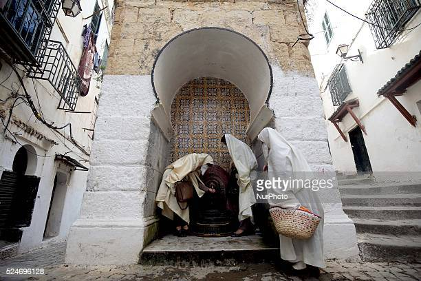 A group of women walk the streets of the Casbah of Algiers with traditional clothing Haik Algiers on photo Bensalem/APP